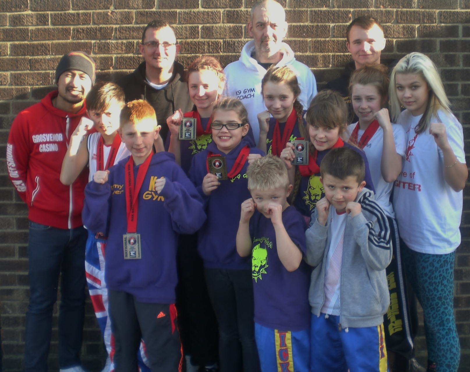 K.9's winning team with proud coaches