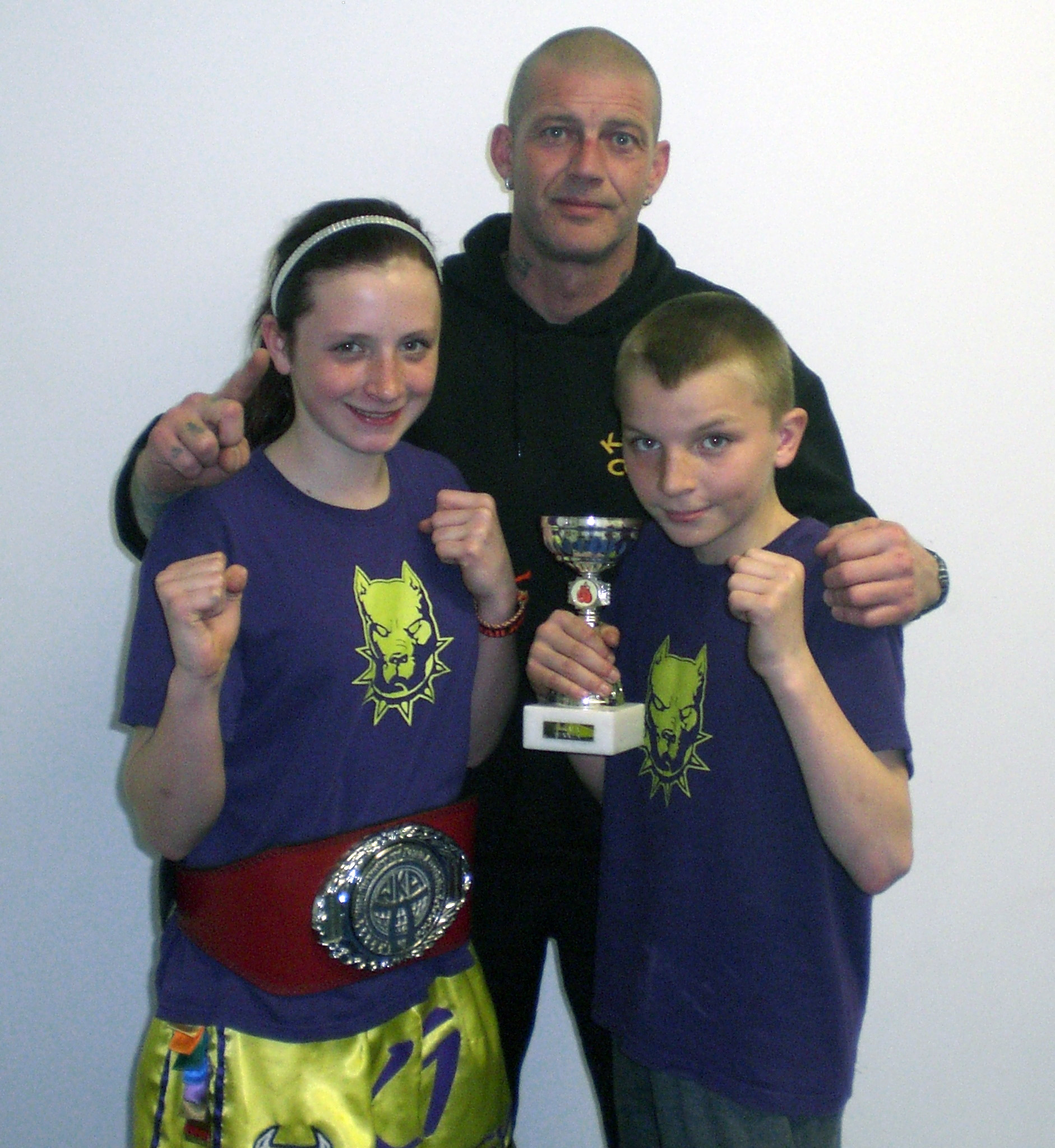 New National Schoolgirl Champion Tia Sayer with Coach Dave Munro and fighter of the night Nicky McHugh